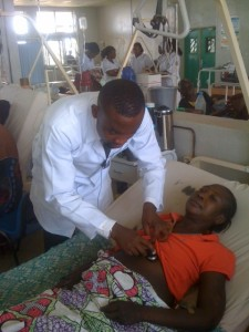 Samuel Ochenehi with a patient